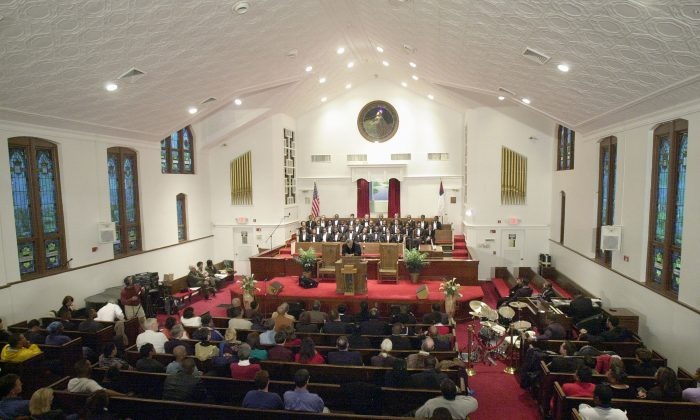 Parishioners sit inside the renovated Ebenezer Baptist Church in Atlanta, Ga., on Jan. 19, 2002. (Erik S. Lesser/Getty Images)