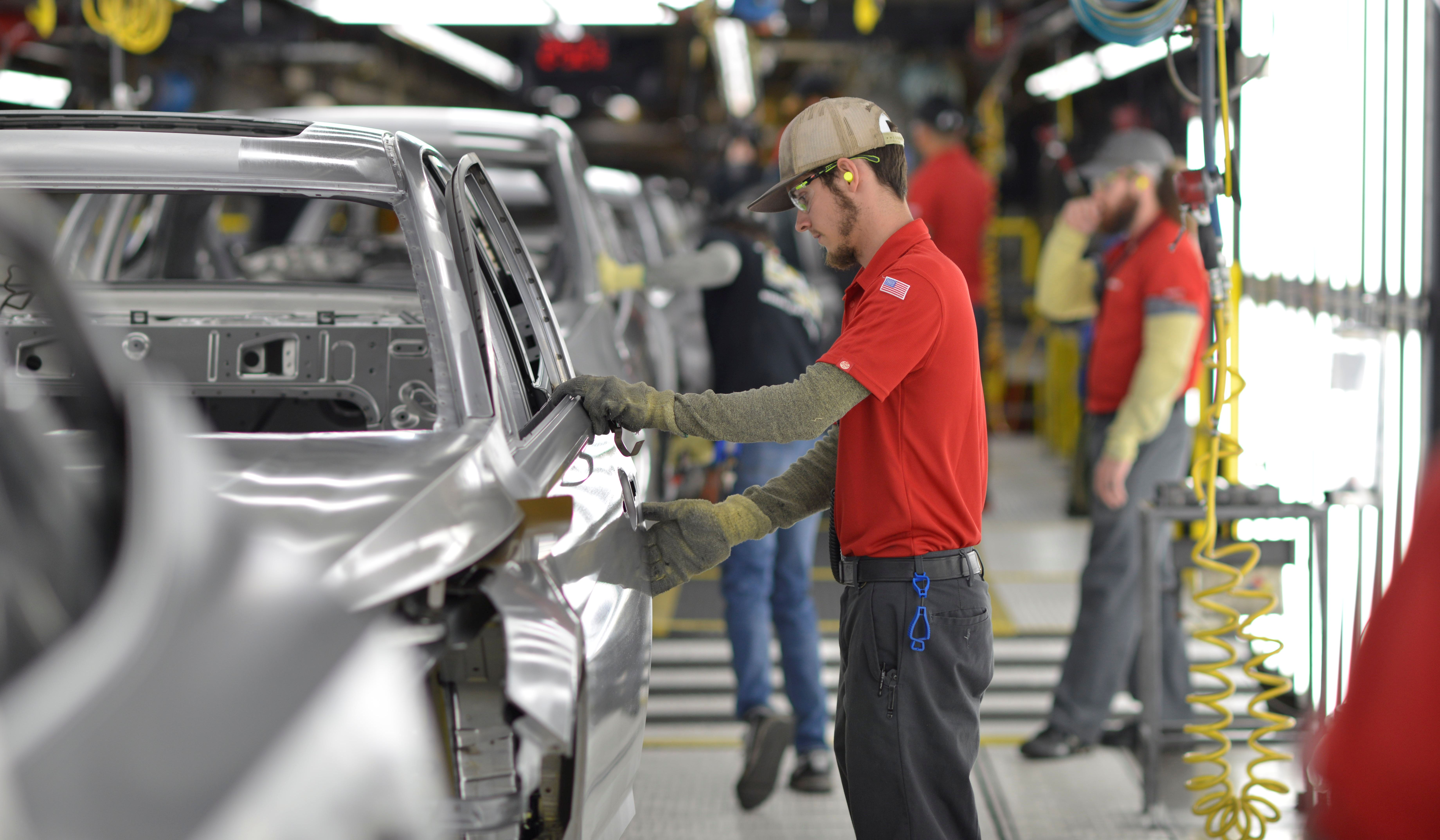 A line worker checks frames for imperfections at Nissan Motor Co's automobile manufacturing plant in Smyrna