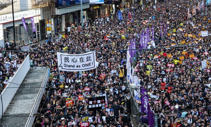 Protesters march on Hong Kong streets during the annual rally on July 1, 2019. (Yu Gang/The Epoch Times)