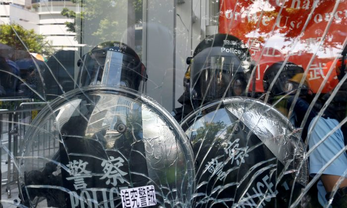 Riot police inside the Legislative Council building where protesters try to break into, during the anniversary of Hong Kong's handover to China in Hong Kong, China July 1, 2019. (Thomas Peter/Reuters)