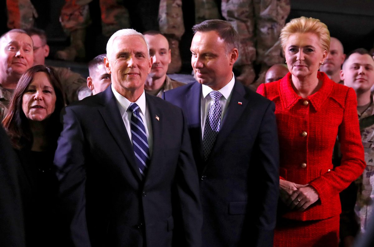 U.S. Vice President Mike Pence, his wife Karen, Polish President Andrzej Duda and his wife Agata Kornhauser-Duda are seen after Pence's arrival at the airport in Warsaw