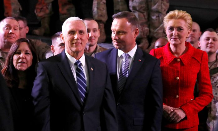 U.S. Vice President Mike Pence, his wife Karen, Polish President Andrzej Duda and his wife Agata Kornhauser-Duda are seen after Pence's arrival at the airport in Warsaw, Poland, on Feb. 13, 2019. (Kacper Pempel/Reuters)