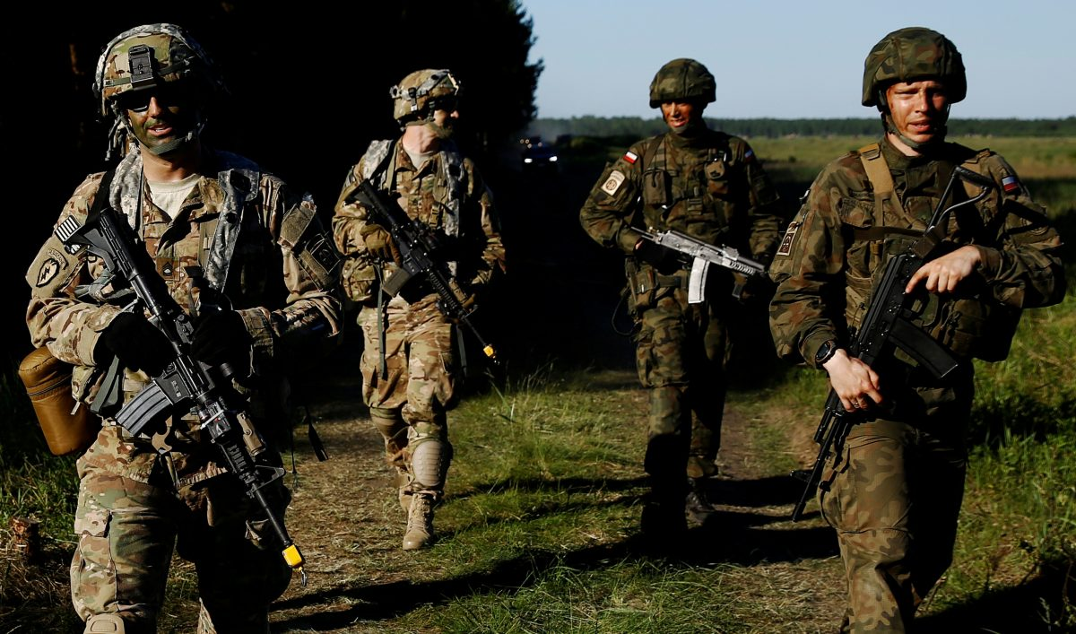 Poland's 6th Airborne Brigade soldiers walk with U.S. 82nd Airborne Division soldiers during the NATO allies' Anakonda 16 exercise near Torun
