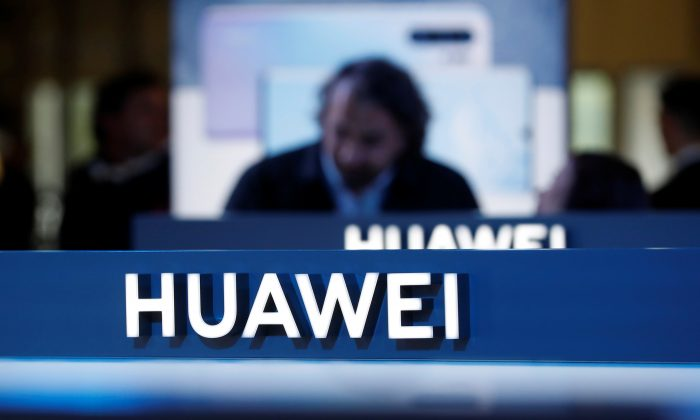 The Huawei logo is pictured on the company's stand during the 'Electronics Show at Ptak Warsaw Expo in Nadarzyn, Poland on May 10, 2019. (Kacper Pempel/Reuters)