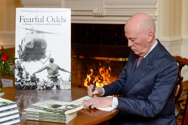 Newhall signing his book