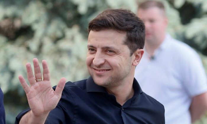 Ukrainian President Volodymyr Zelenskiy, greets media prior his meeting with German Foreign Minister Heiko Maas and French Foreign Minister Jean-Yves Le Drian in Kiev, Ukraine on May 30, 2019. (Efrem Lukatsky/AP, The Canadian Press)