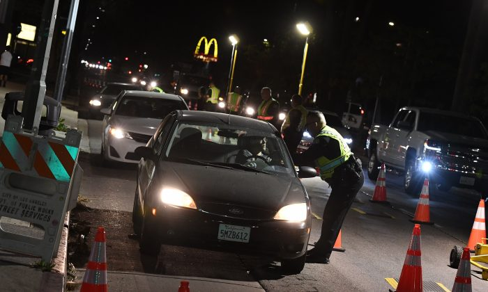 A driver is questioned at a Los Angeles police DUI checkpoint on April 13, 2018. (MARK RALSTON/AFP/Getty Images)