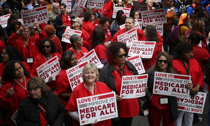 "Protesters supporting ""Medicare for All"" hold a rally outside PhRMA headquarters April 29, 2019 in Washington, DC. The rally was held by the group Progressive Democrats of America.  Win McNamee/Getty Images"