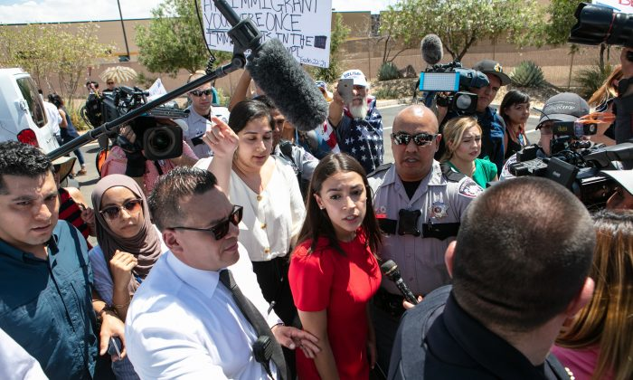 Rep. Alexandria Ocasio-Cortez (D-NY) is swarmed by the media after touring the Clint, TX Border Patrol Facility housing children in  in Clint, Texas on July 1, 2019. (Christ Chavez/Getty Images)