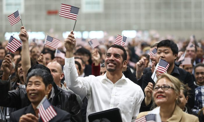 New U.S. citizens wave American flags at a naturalization ceremony in Los Angeles on March 20, 2018. (Mario Tama/Getty Images)