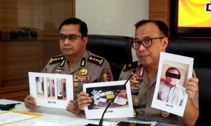 Indonesian police personnel show photographs of Para Wijayanto, leader of the terrorist group Jemaah Islamiah, and various seized items at a press conference in Jakarta on July 1, 2019. (AFP/Getty Images)