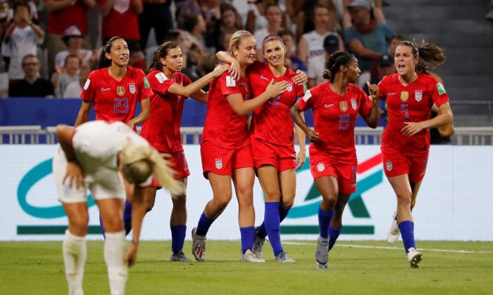 United Sates' Alex Morgan celebrates scoring their second goal with Lindsey Horan and team mates during the Women's World Cup semifinal soccer match between England and the United States, at the Stade de Lyon, outside Lyon, France, on July 2, 2019. (Bernadett Szabo/Reuters)
