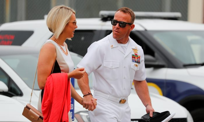 U.S. Navy SEAL Special Operations Chief Edward Gallagher arrives at court with his wife Andrea for the start of his court-martial trial at Naval Base San Diego in San Diego, Calif., on June 18, 2019.  (Mike Blake/Reuters)