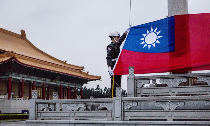 Honor guards prepare to raise the Taiwan flag in the Chiang Kai-shek Memorial Hall square ahead of the Taiwanese presidential election in Taipei, Taiwan on January 14, 2016. (Ulet Ifansasti/Getty Images)