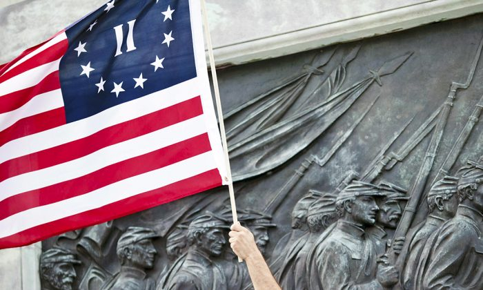 A Betsy Ross American flag waves at a Tea Party Express rally in Washington, on Sept. 12, 2009. (Brendan Smialowski/Getty Images)