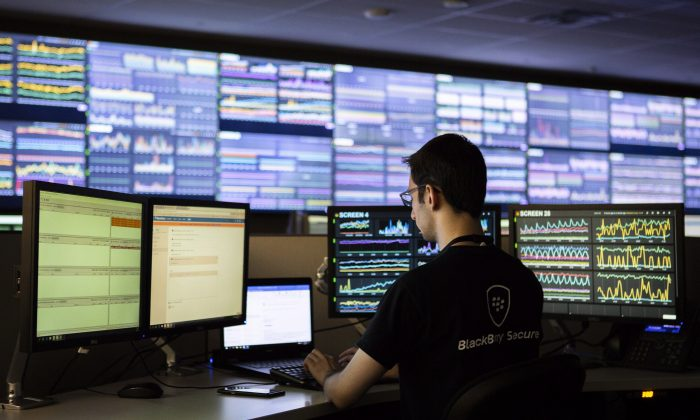 A BlackBerry employee works at the company's Network Operating Centre in Waterloo, Ont., in this file photo. BlackBerry is one Canadian company that grew into serving consumers and businesses globally. (The Canadian Press/Andrew Ryan)