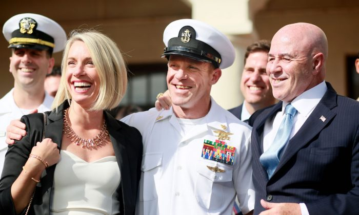 Navy Special Operations Chief Edward Gallagher and his wife Andrea celebrate after being acquitted of all but one charge in San Diego, Calif., on July 2, 2019. (Sandy Huffaker/Getty Images)