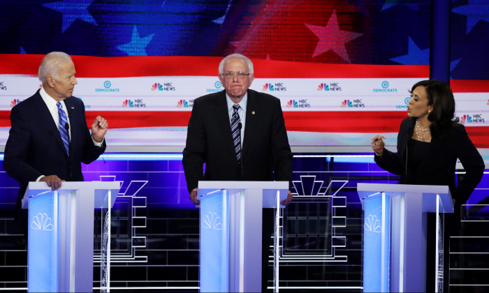 Sen. Kamala Harris (R) (D-CA) and former Vice President Joe Biden (L) speak as Sen. Bernie Sanders (I-VT) looks on during the second night of the first Democratic presidential debate on June 27, 2019 in Miami, Florida. (Drew Angerer/Getty Images)