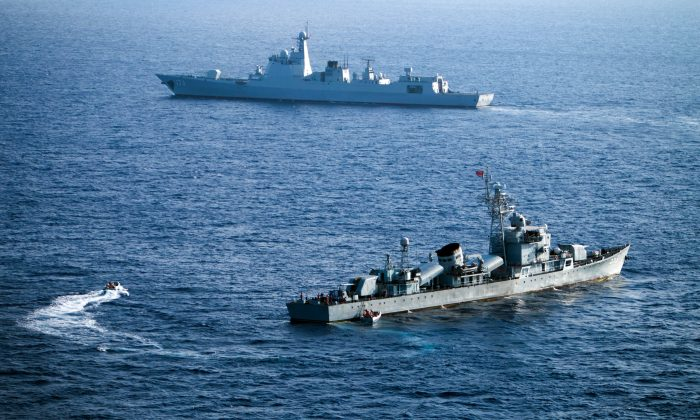 This photo taken on May 5, 2016 shows crew members of China's South Sea Fleet taking part in a drill in  the Paracel Islands in the South China Sea. (STR/AFP/Getty Images)