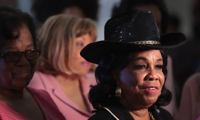 Rep. Frederica Wilson (D-FL) greets guests at a prayer vigil she was hosting at the Greater Historic Bethel AME Church in Miami, Florida, on Jan. 30, 2018. (Scott Olson/Getty Images)
