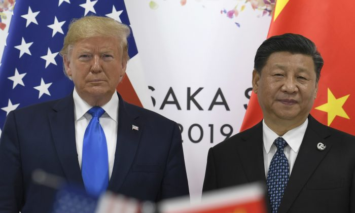 President Donald Trump,  poses for a photo with Chinese leader Xi Jinping during a meeting on the sidelines of the G-20 summit in Osaka, Japan on June 29, 2019. (AP Photo/Susan Walsh)