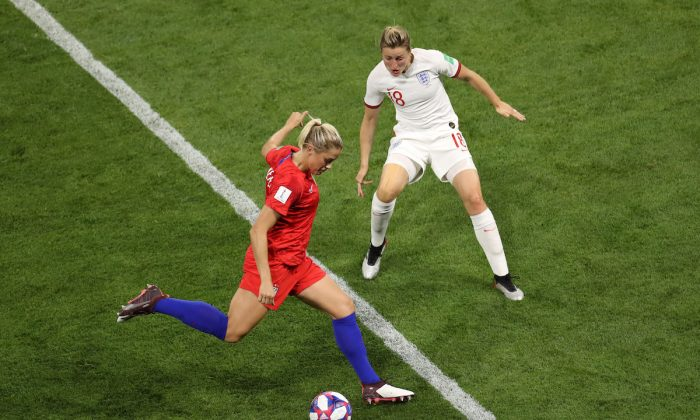 Abby Dahlkemper of the USA is challenged by Ellen White of England during the 2019 FIFA Women's World Cup France Semi Final match between England and USA at Stade de Lyon on July 02, 2019 in Lyon, France. (Maja Hitij/Getty Images)