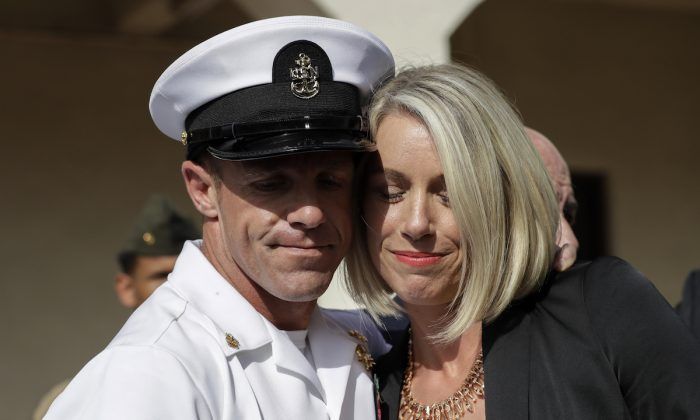 Navy Special Operations Chief Edward Gallagher (L) and his wife, Andrea Gallagher hug after leaving a military court on Naval Base San Diego in San Diego, on July 2, 2019. (Gregory Bull/AP Photo)