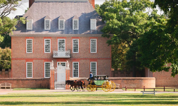 A carriage passes by the Governor's Palace. The palace was built to project British authority. (Colonial Williamsburg Foundation/Colonial Williamsburg)
