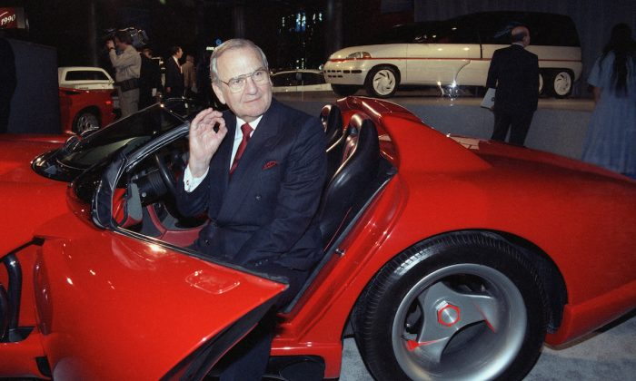 Chrysler Corporation Chairman Lee A. Iacocca sits in a 1990 Dodge Viper sports car as the ?Chrysler in the 90's six city tour makes a visit to New York, on March 28, 1990. (Osamu Honda/AP Photo)