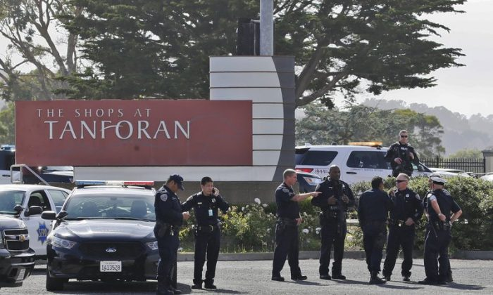 Police investigate at the scene of a shooting at the Tanforan Mall in San Bruno, Calif., on July 2, 2019. (Stephanie Mullen/AP Photo)