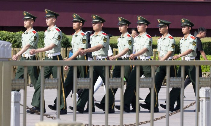 Chinese paramilitary police march past Tiananmen Gate on the eve of the 30th anniversary of the 1989 crackdown on pro-democracy protest in Beijing on June 3, 2019. (AP Photo/Ng Han Guan)