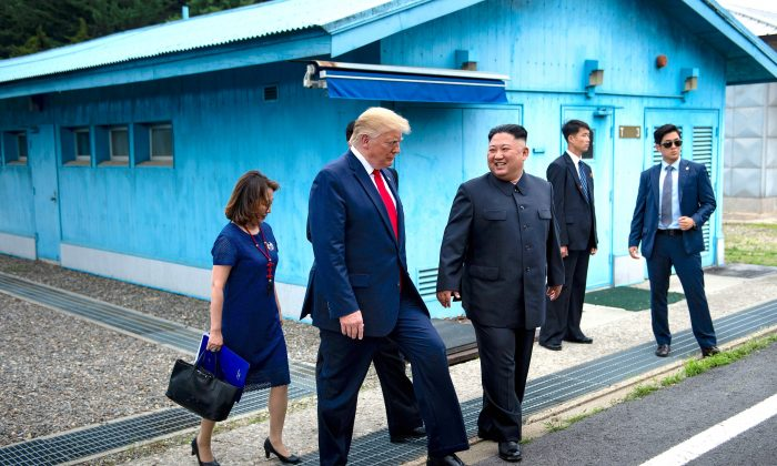 President Donald Trump and North Korean leader Kim Jong Un walk together south of the Military Demarcation Line that divides North and South Korea on June 30, 2019. (Brendan Smialowski/AFP/Getty Images)