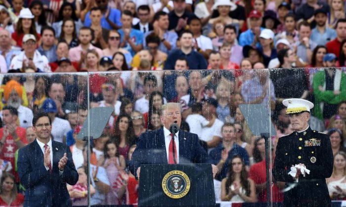 """President Donald Trump speaks alongside acting Defense Secretary Mark Esper (L) and the Chairman of The Joint Chiefs of Staff Joseph Dunford during the """"Salute to America"""" Fourth of July event at the Lincoln Memorial in Washington, on July 4, 2019. (Brendan Smialowski/AFP)"""