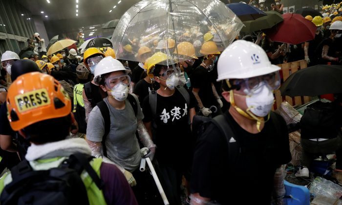 Anti-extradition bill protesters wearing helmets gather outside the Legislative Council building on the anniversary of Hong Kong's handover to China in Hong Kong, China on July 1, 2019. (Tyrone Siu/Reuters)
