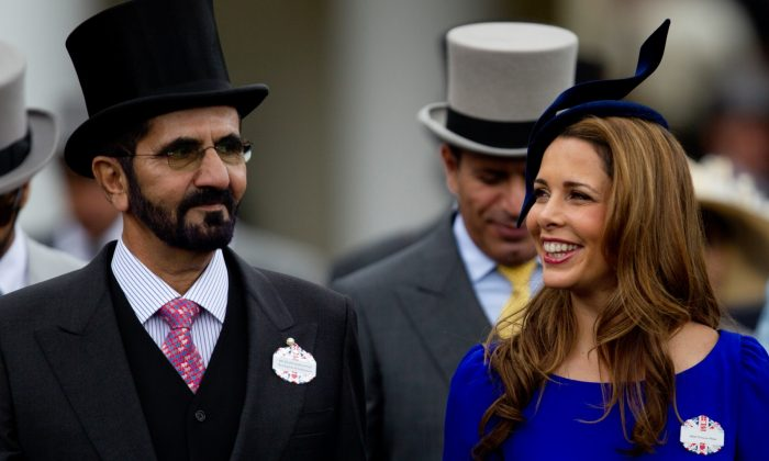 Sheikh Mohammed Al Maktoum and his wife Princess Haya of Jordan walk towards the paddock on the second day of Royal Ascot horse race meeting at Ascot, England on June 20, 2012. (Alastair Grant/File Photo via AP)