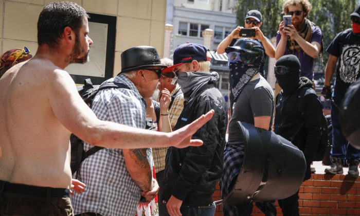 A man who was later assaulted by Antifa, second from left, faces off with Rose City Antifa members at Pioneer Courthouse Square in Portland, Ore., on June 29, 2019. (Moriah Ratner/Getty Images)