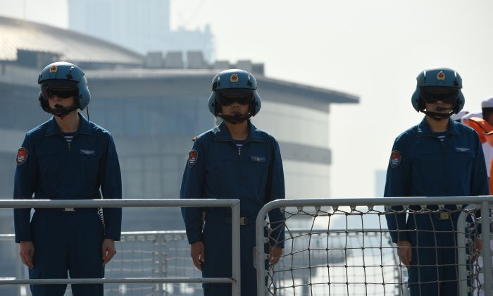 Chinese pilots onboard the guided-missile frigate Wuhu (539) stand in formation shortly after docking at the international port in Manila, Philippines on Jan. 17, 2019. (Ted Aljibe/AFP/Getty Images)