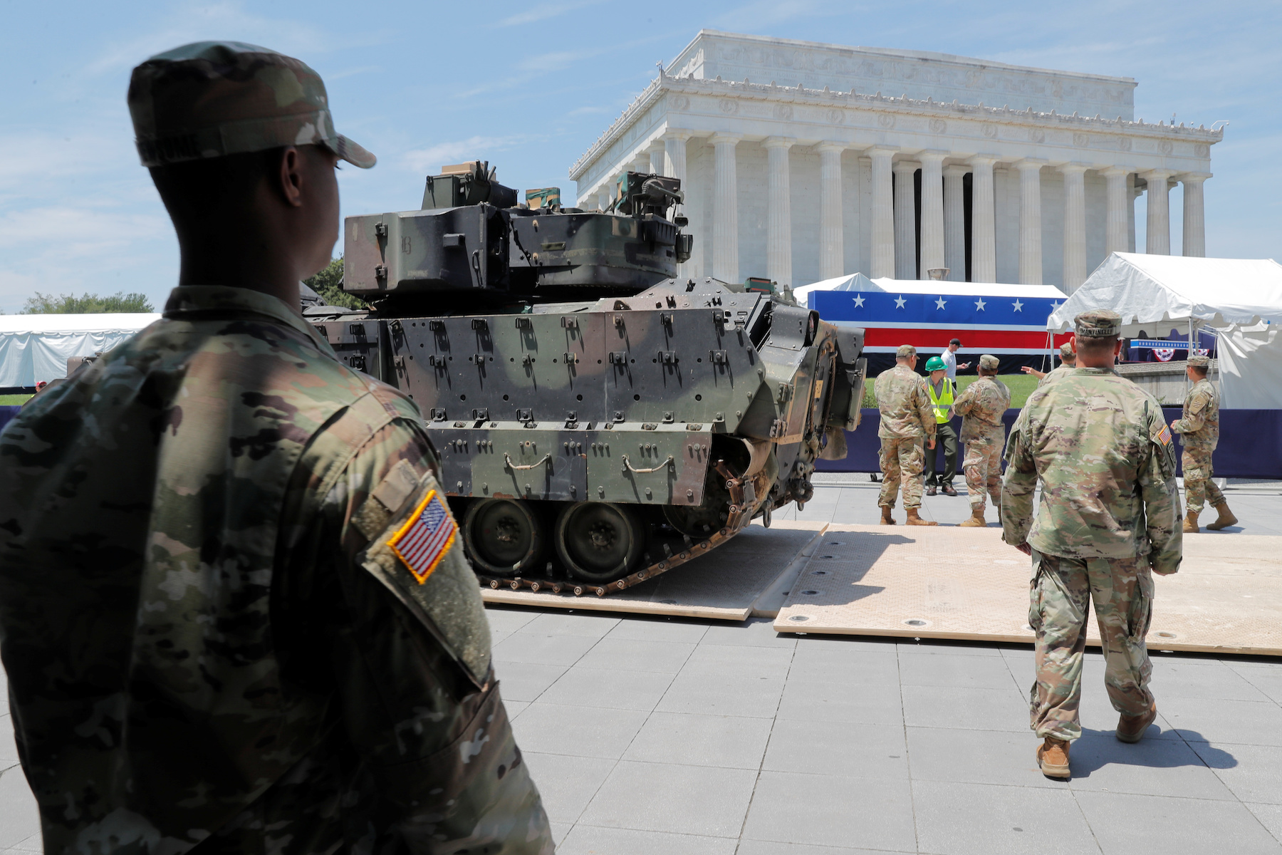 A Bradley Fighting Vehicle is moved into place as July Fourth preparations continue at Lincoln Memorial in Washington