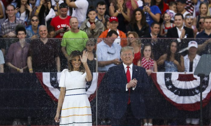 """President Donald Trump and First Lady Melania Trump arrive on stage for the """"Salute to America"""" event in front of the Lincoln Memorial in Washington, on July 4, 2019. (Charlotte Cuthbertson/The Epoch Times)"""