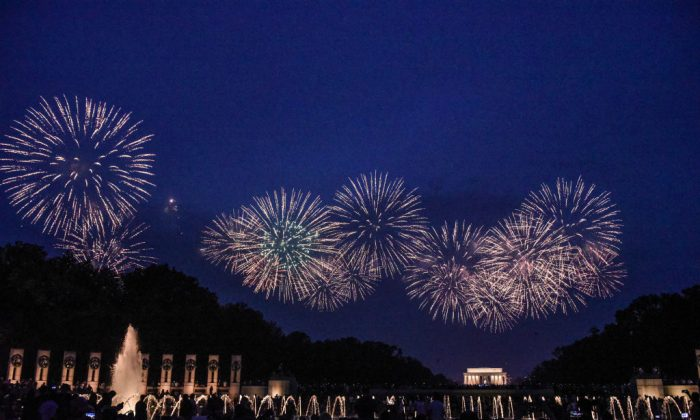 People watch the fireworks display on the National Mall during Fourth of July festivities  in Washington, D.C. on July 4, 2019. (Stephanie Keith/Getty Images)