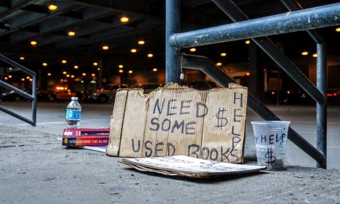 File photo of a cardboard sign similar to one used by panhandlers. (Maarten van den Heuvel/Unsplash)