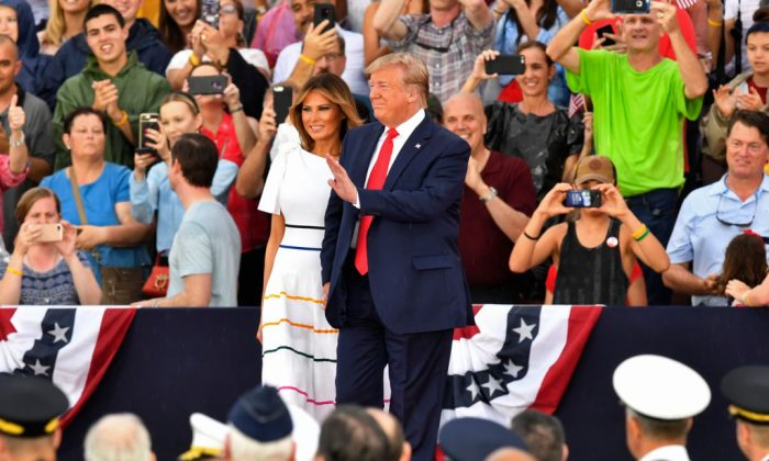 "U.S. President Donald Trump and the First Lady arrive at the ""Salute to America"" Fourth of July event at the Lincoln Memorial in Washington, D.C., on July 4, 2019. (NICHOLAS KAMM/AFP/Getty Images)"