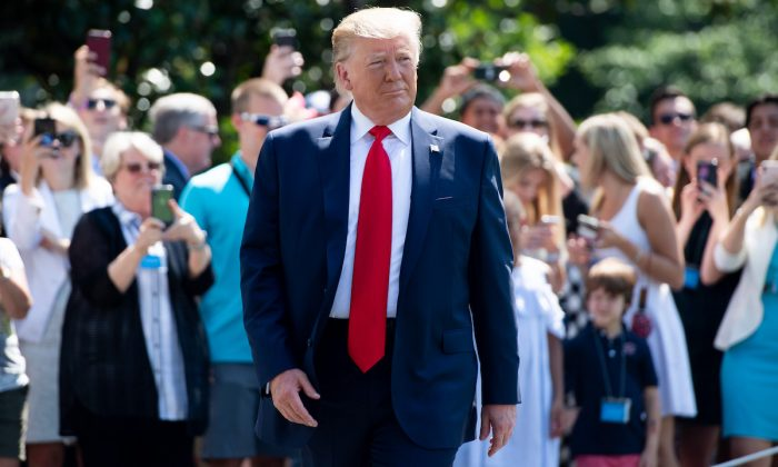 US President Donald Trump walks to speak to the media prior to departing on Marine One from the South Lawn of the White House in Washington, DC, July 5, 2019. (Saul Loeb/AFP/Getty Images)