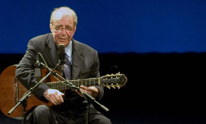Brazilian musician Joao Gilberto, 77, acknowledges the audience during his presentation late at night at the Teatro Municipal in Rio de Janeiro on Aug. 24, 2008. (ARI VERSIANI/AFP/Getty Images)