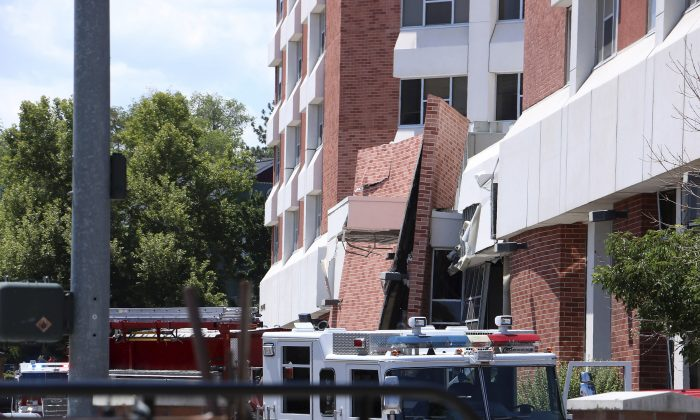 Rescue personnel respond to an explosion that damaged Argenta Hall and Nye Hall on the University of Nevada, Reno campus in Reno, Nev., on July 5, 2019. (Jason Bean/The Reno Gazette-Journal via AP)