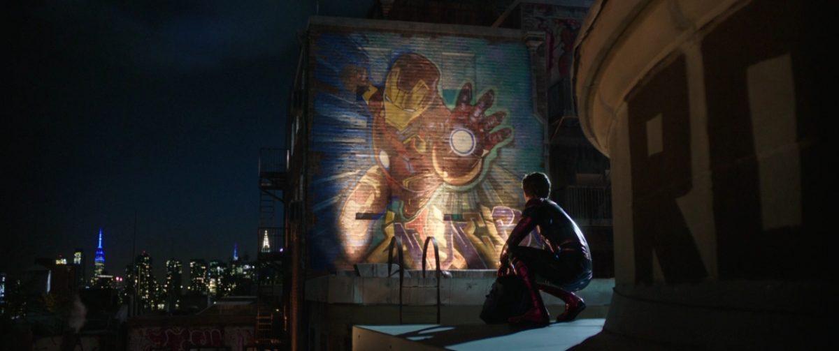 Spiderman in front of Ironman graffiti