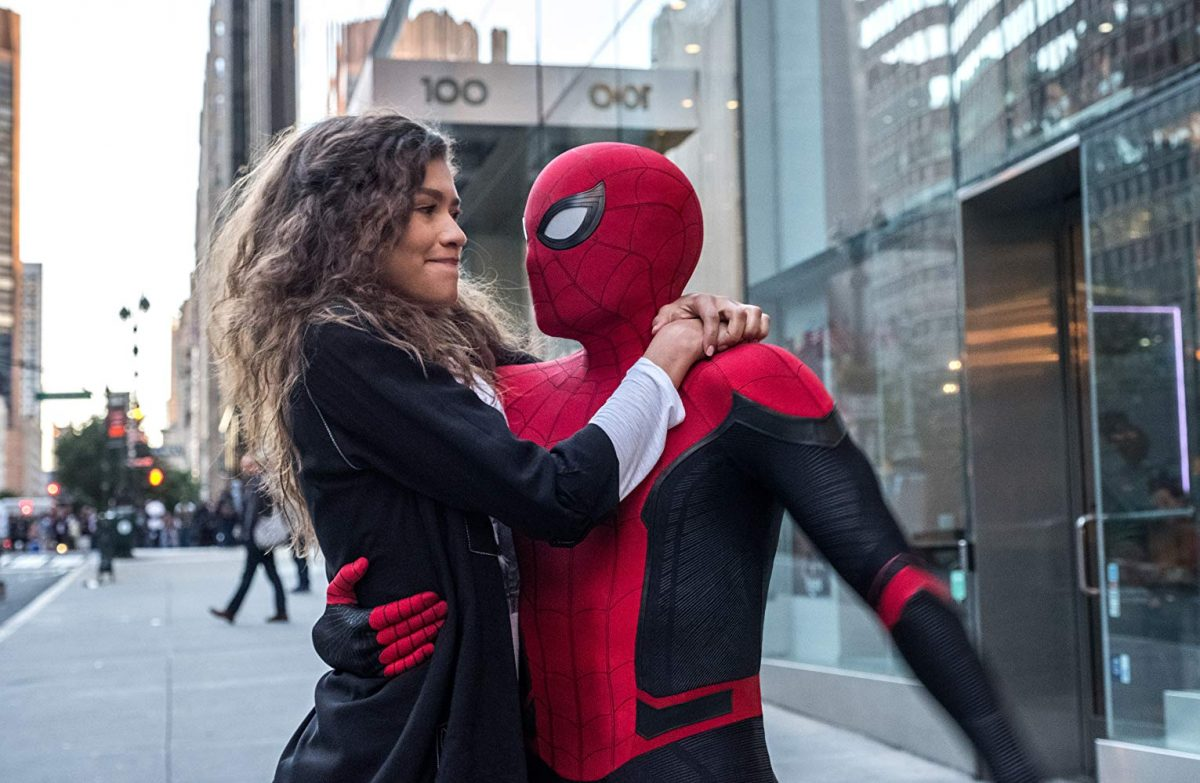 young woman hugging Spiderman