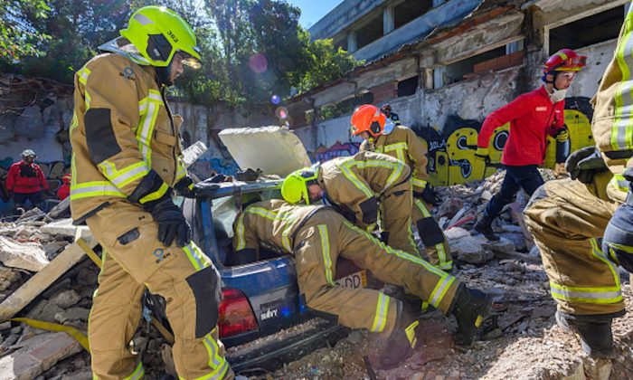"Portuguese firefighters from Cascais Municipality rescue ""victims"" trapped inside cars during a CASCADE-19 EU civil protection exercise simulated earthquake related event staged at an abandoned building in Alcabideche, Portugal on May 31, 2019. (Horacio Villalobos, Corbis/Corbis via Getty Images)"