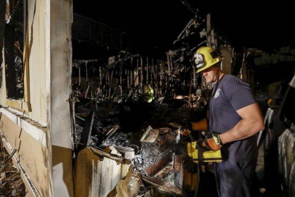 A fireman looks over a home