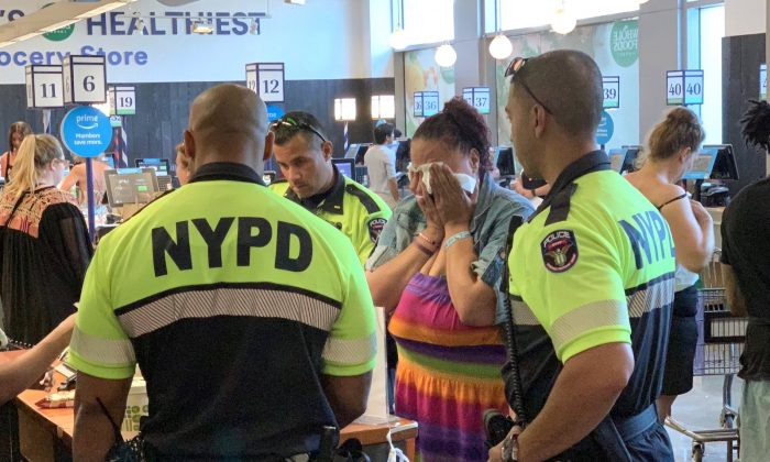 NYPD police officers did not arrest a woman who was accused of shoplifting food, but instead paid for the food at a Union Square Whole Foods store in New York, on July 4, 2019. (Paul Bozymowski @pboz/Twitter)